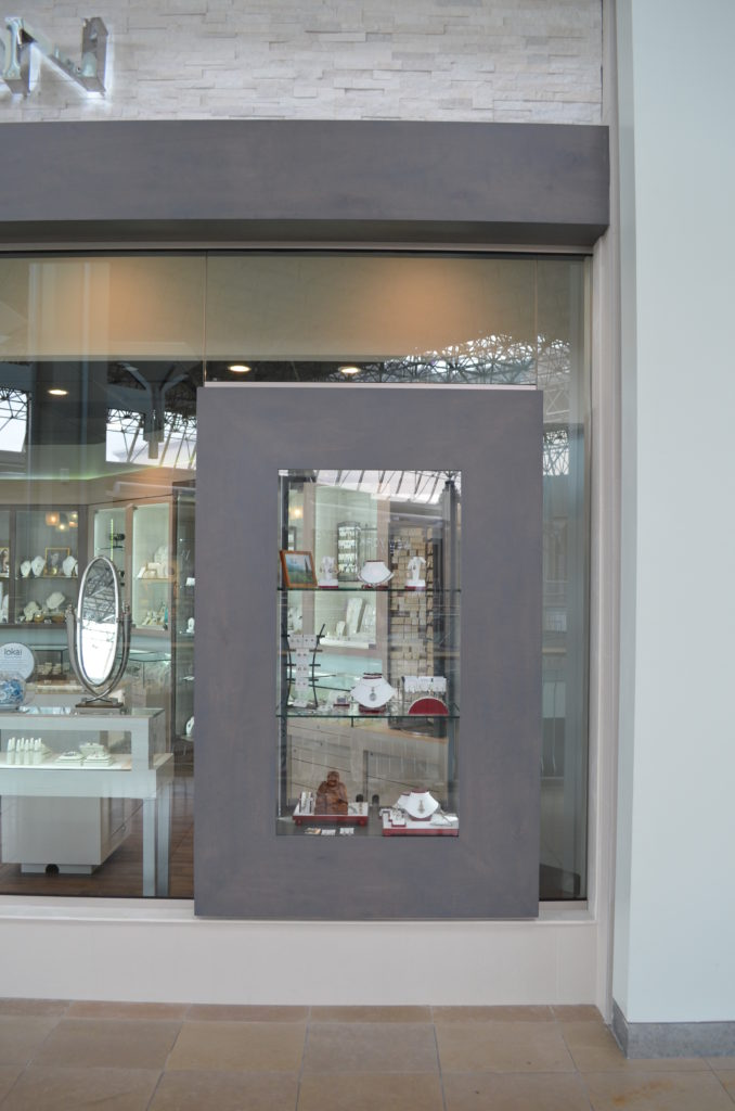 One of the main features of the renovation was the addition of two display cases that seem to be floating in the glass. This created a focal point and helped showcase the product. There are two on either side of the store.